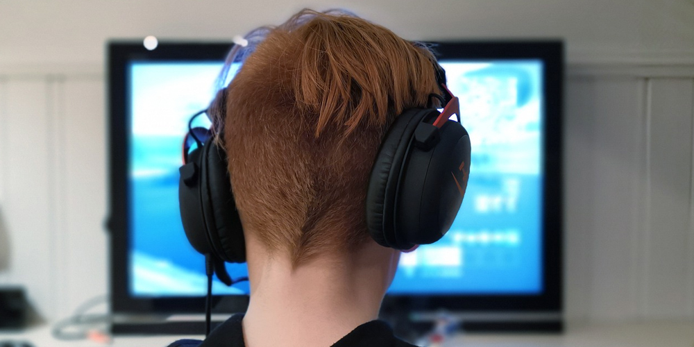 boy gaming with headset